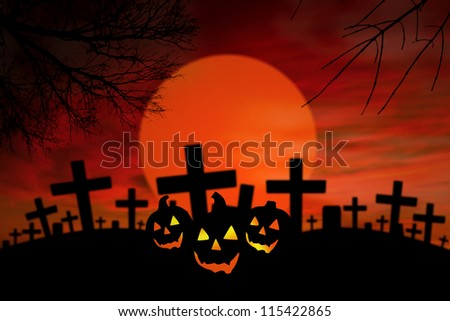 Halloween Jack O Lantern in spooky graveyard during full moon - stock photo