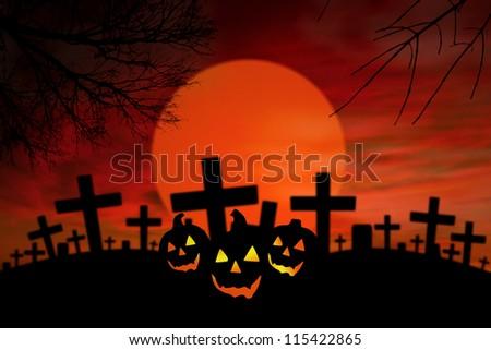 Halloween Jack O Lantern in spooky graveyard during full moon - stock photo