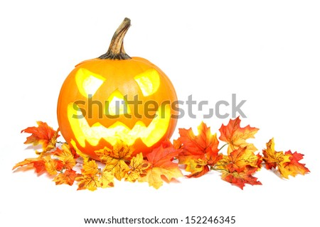 Halloween Jack o Lantern on red autumn leaves over white - stock photo
