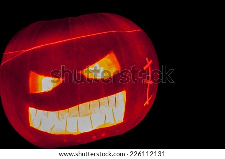 Halloween Jack o'lantern. Pumpkin carved to create a scary face for Halloween. - stock photo