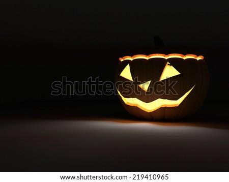 Halloween Jack O Lantern Pumpkin on dark background with Fire Light Inside  - stock photo