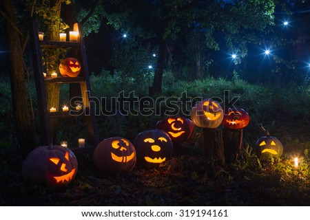 Halloween Jack-o-Lantern pumpkins outdoor - stock photo