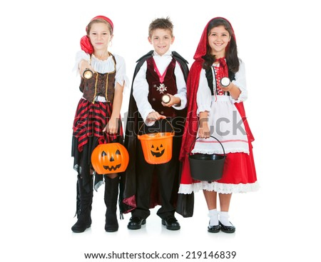 Halloween: Kids Being Safe With Flashlights While Trick Or Treating - stock photo