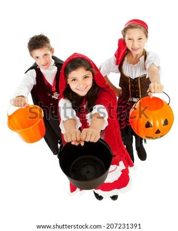 Halloween: Kids Trick Or Treating In Fun Costumes - stock photo
