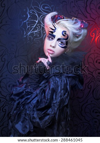 Halloween/Lady in black. Young woman in creative magic image. - stock photo