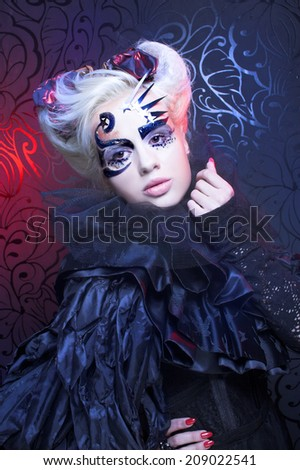 Halloween Lady. Young woman in creative dark image. - stock photo