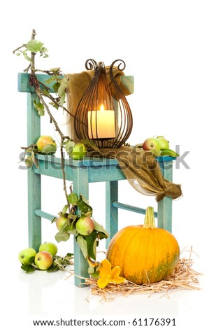 Halloween lantern on rustic chair decorated with apples and pumpkin - stock photo