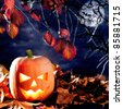 halloween lantern pumpkin  in dark sky clouds moonlight [Photo Illustration] - stock photo
