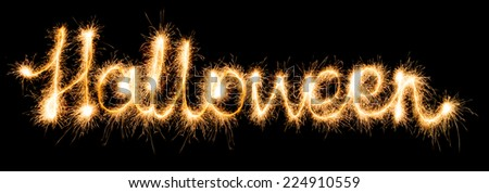 Halloween made of sparkles on black background - stock photo