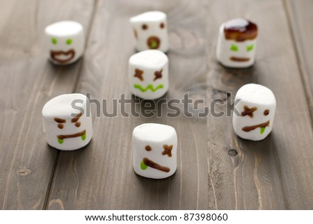 Halloween marshmallow zombies on a wooden background - stock photo