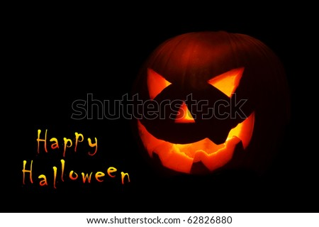 Halloween nightmare with glowing jack-o-lantern in the darkness - stock photo