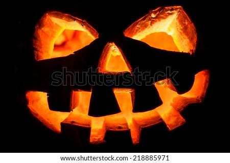 Halloween - old jack-o-lantern on black background - stock photo