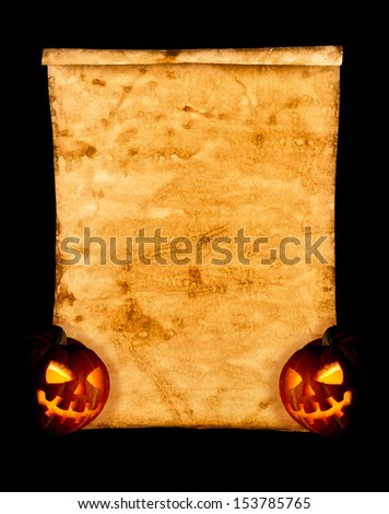 Halloween. Old paper and pumpkin on a black background. Empty billboard or an invitation to a celebration. - stock photo
