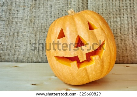 Halloween orange pumpkin on a wooden background in a rustic style. Beautiful autumn Pumpkins Halloween background with place for text - stock photo
