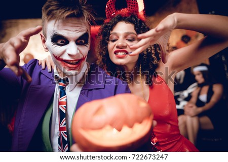 Halloween party. A guy in a Joker costume and a girl in a demon costume  sc 1 st  Shutterstock & Halloween Party Guy Joker Costume Girl Stock Photo (Royalty Free ...