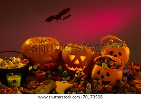 Halloween party decorations with carved pumpkins - stock photo