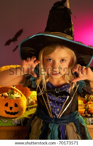 Halloween party with a child wearing scaring costume