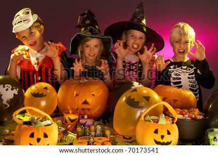 Halloween party with children wearing fancy costumes - stock photo