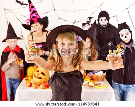 Halloween party with group children holding trick or treat. - stock photo