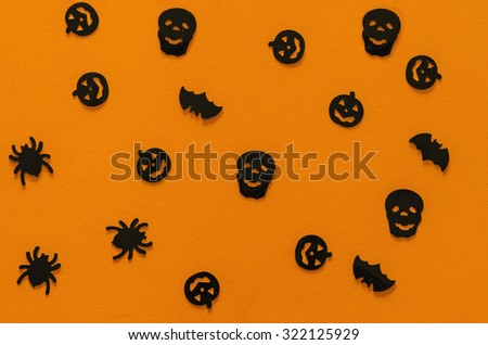 Halloween pattern in orange with skulls, spiders an pumpkins in black. Halloween background - stock photo