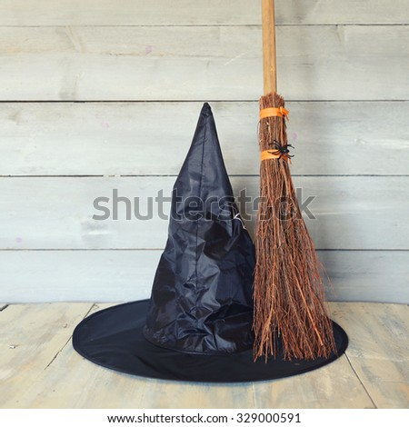 Halloween photo with witch hat and broom - stock photo