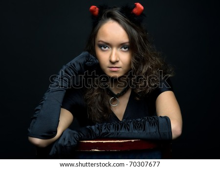 Halloween. Portrait of the beautiful woman in devil costume