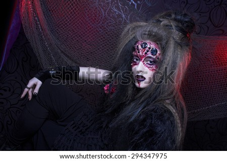 Halloween. Portrait of young woman in dark artistic image of Spider-queen - stock photo