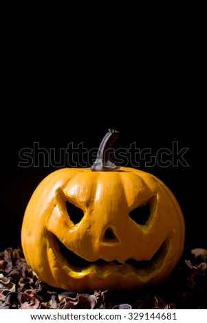 Halloween pumpkin and autumn leaves - stock photo