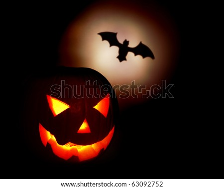 Halloween pumpkin and bat isolated on black background - stock photo