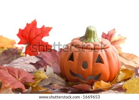 halloween pumpkin and leaves - stock photo