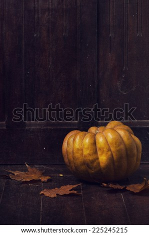 Halloween pumpkin and maple leaves  - stock photo