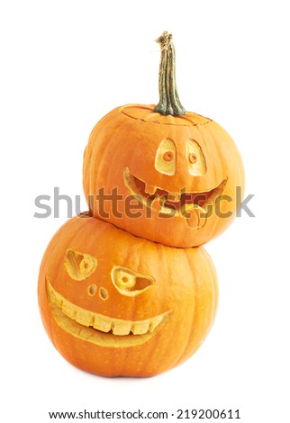 Halloween pumpkin composition with one Jack-o'-lanterns pumpkin head placed over another one, composition isolated over the white background - stock photo