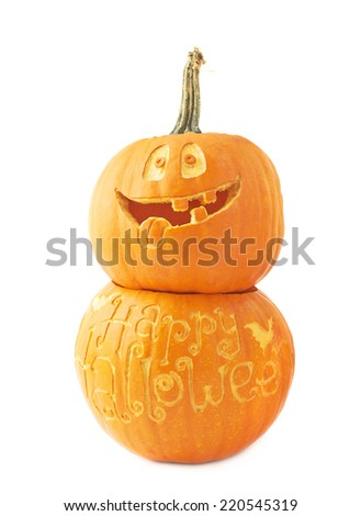 Halloween pumpkin composition with one Jack-o'-lanterns pumpkin head placed over the Happy Halloween pumpkin, composition isolated over the white background - stock photo