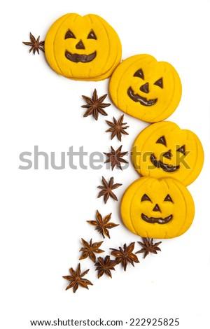 halloween pumpkin cookies & star anise on white - stock photo