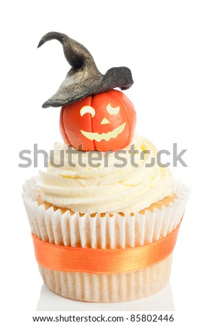 Halloween pumpkin cupcake wearing a witches hat on white background - stock photo