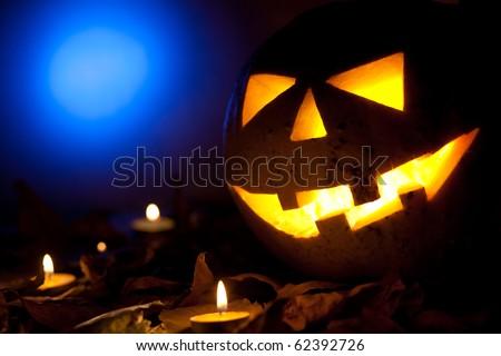 Halloween pumpkin glowing in the dark - stock photo