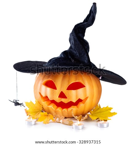 Halloween pumpkin head jack lantern with burning candles isolated on white background. Halloween holidays art design, celebration. Carved Halloween Pumpkin in witch hat with a spider - stock photo