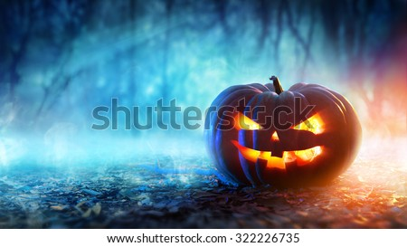 Halloween Pumpkin In A Mystic Forest At Night  - stock photo