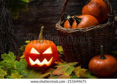 Halloween pumpkin in autumn leaves - stock photo