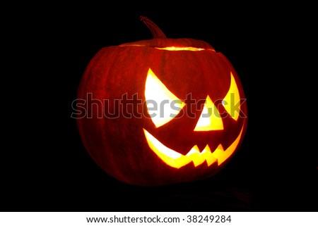 Halloween pumpkin Jack-O-Lantern on a black background - stock photo