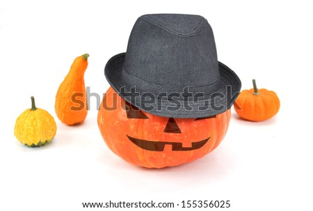 Halloween pumpkin  Jack O'lantern  wearing a hat - stock photo