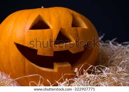 Halloween pumpkin Jack-O-Lantern with happy face over grey background - stock photo