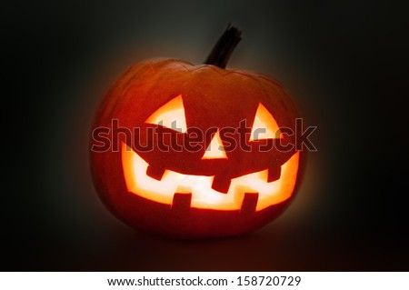 Halloween Pumpkin Jack O Latern on dark background