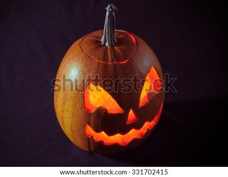 Halloween pumpkin on dark background. View above - stock photo