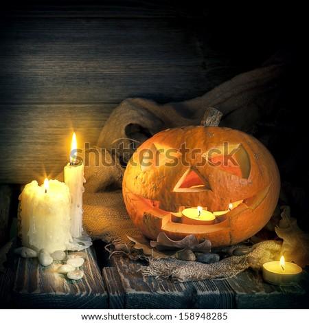 Halloween pumpkin on on a wooden background - stock photo