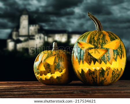 Halloween pumpkin on wooden planks with blur background. - stock photo