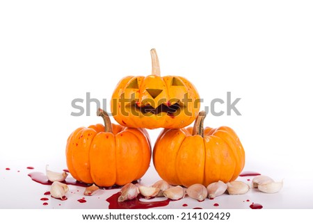 halloween pumpkin red blood on white backgroud - stock photo