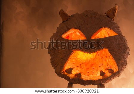 Halloween pumpkin with a light into the shadows, Tone flame background.