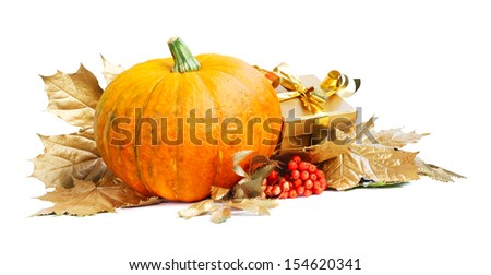 Halloween pumpkin with autumn leafs and gift isolated on white