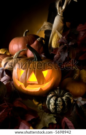 halloween pumpkin with autumn leaves close up - stock photo